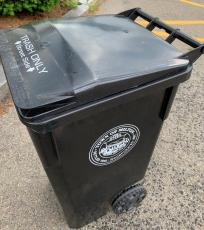 Black trash cart with Milton seal