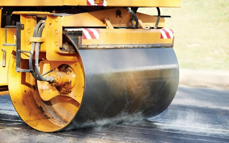 Image of Steamroller paving